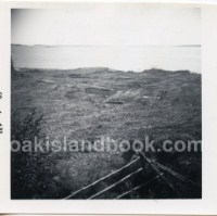 Description on back of photo: Oak Island taken a top of scaffolding on top of the Money Pit looking towards South Shore