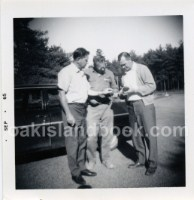 Robert Dunfield, James Troutman, Dan Blankenship outside of Oak Island Motel